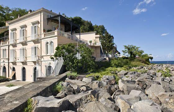 Sicily - Crossing The Rock Villa - villa built into cliffs overlooking fishing port of Santa Maria La Scala