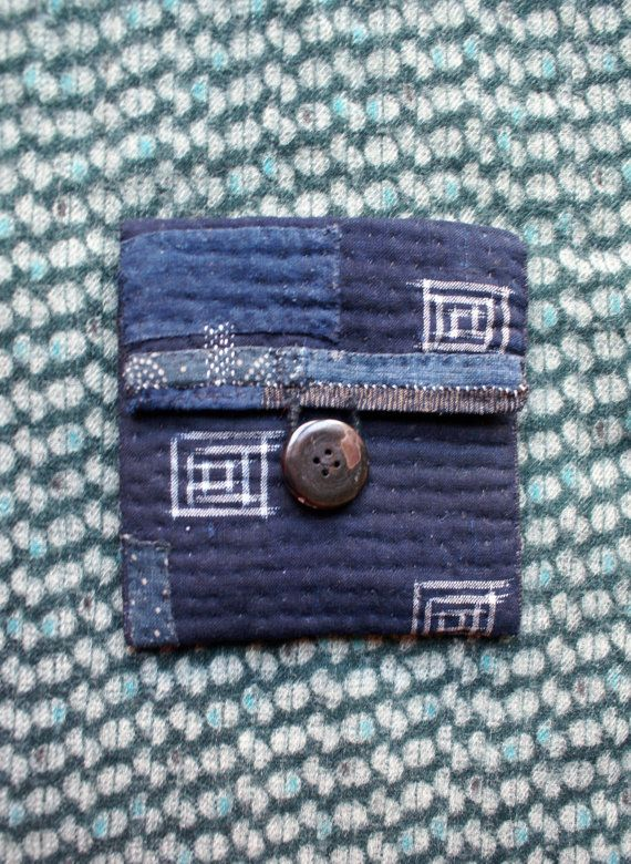 hand sewn pouch in antique Japanese cottons : dark indigo kasuri (ikat) cotton, with patches in lighter shades of blue ; inspired by sashiko and boro, kantha, recycled fabrics and folk textiles on their way for a new life... the Inside lining is in japanese plain and striped indigo cotton the inner filling is 100 % cotton it closes with a loop in linen twine and a mother of pearl button this pouch is perfect for business cards,for storing a precious thing (jewel, photo...), or for a spiri...