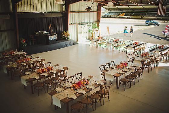 How fun! A wedding reception in an airplane hangar!