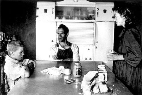 Family at lunch. A photo by David Goldblatt, 1962