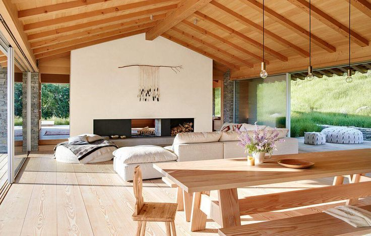 """The airy living area of Joanne and Rico Zorkendorfer's Jackson hole, Wyoming, getaway shows their affinity for natural, wide-open spaces—both inside and out. """"I have a love affair with New Zealand's wide-open beach houses, and Rico has an affinity for chalets, so we wanted to create something that was a marriage of those two things,"""" Joanne explains. Take the full home tour through the #linkinbio Photo by @trevortondro; text by @dominic_bradbury; design by @mcleanquinlan"""