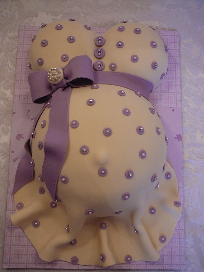 Baby Shower Pregnant Belly Cake by Patisserie Jaja  Vanilla cake with buttercream covered with fondant. Jewel on the bow, all edible.