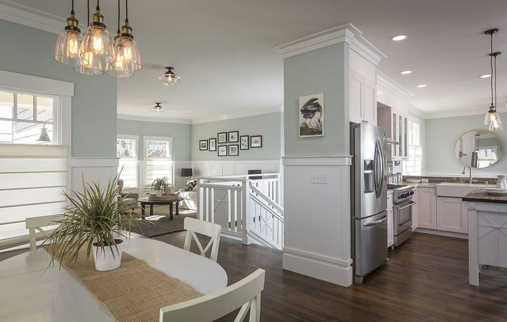 The open floor plan integrates the living and dining rooms with the modern kitchen.  Photo: Scott Hargis Photography