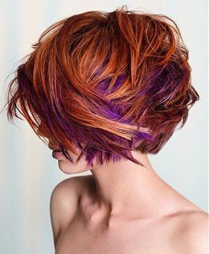 Peek-a-boo highlights- These vibrant purple highlights are layered and camouflaged within the red locks.It is perfect in the way that red and purple are complementary colors, and work together marvelously for this fiery look.