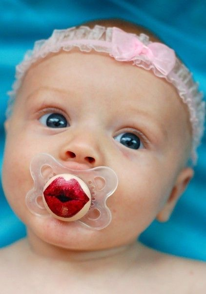 I don't want this baby to get into using a pacifier but if she has to I'd get her a cute one like this