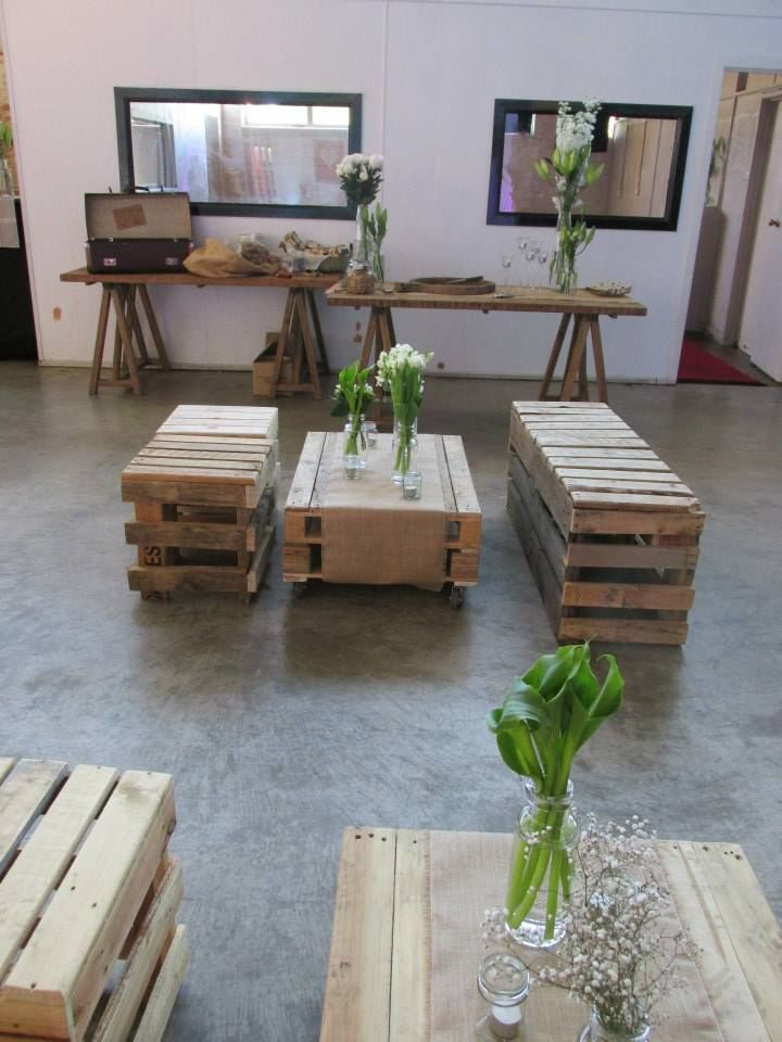 Spring warehouse wedding set up - pallet furniture, festoon lighting and Mexican bunting