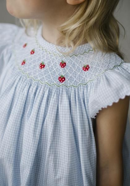 The bishop dress. It's classic, beautiful, and best of all.. TIMELESS! Intricate smocked strawberries dance across the neckline of the swoon-worthy light blue s