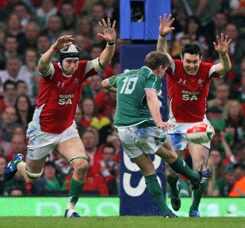 Ireland fly-half Ronan O'Gara kicks a Grand Slam winning drop goal against Wales