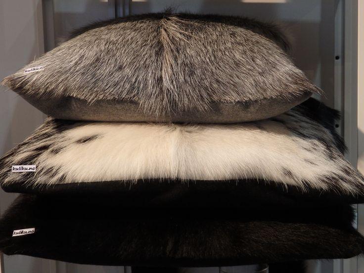 Throw pillows in natural Norwegian goat and calf hides. www.kuliku.no