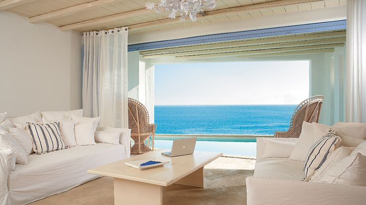 The stunning villas of Mykonos Blu 5 star resort, adorned with natural fabrics in absolute white and blue, offer a breathtaking view to the Aegean.  The Villas are ultra-spacious, airy, and sun-filled with cool shaded terraces. Luxury is everywhere!