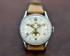 1944 European Watch Company: Omega Vintage Cosmic Triple Date Moon Phase SS