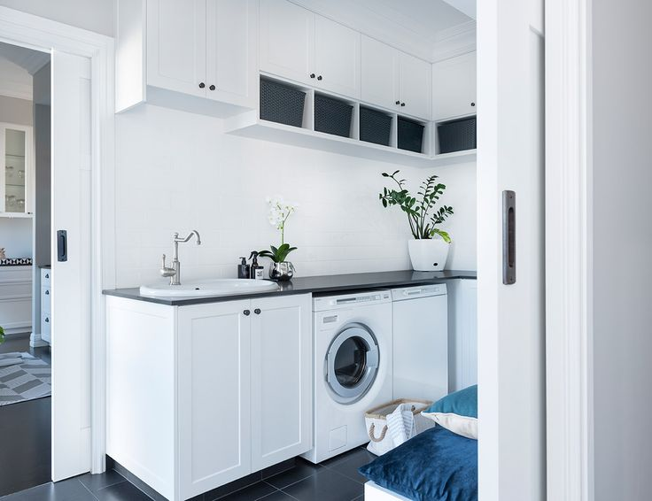 This  Classic Luxe Laundry designed by Colourcube Interiors is effortlessly classy. So much storage, hanging space and room for a drop zone for the teenagers makes this a perfect laundry. Bench top Caesarstone Raven, Shaker door cabinets.