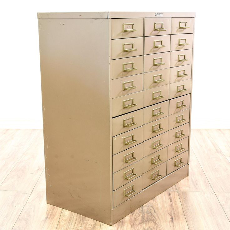 "This ""Art Steel Company"" ""Steelmaster"" card file is featured in a durable metal with a distressed beige finish. This retro industrial filing cabinet has label holder drawer pulls and 30 card file drawers. Perfect for storing paperwork and supplies in a large craft room studio or office! #countryfarmhouse #storage #filecabinet #sandiegovintage #vintagefurniture"