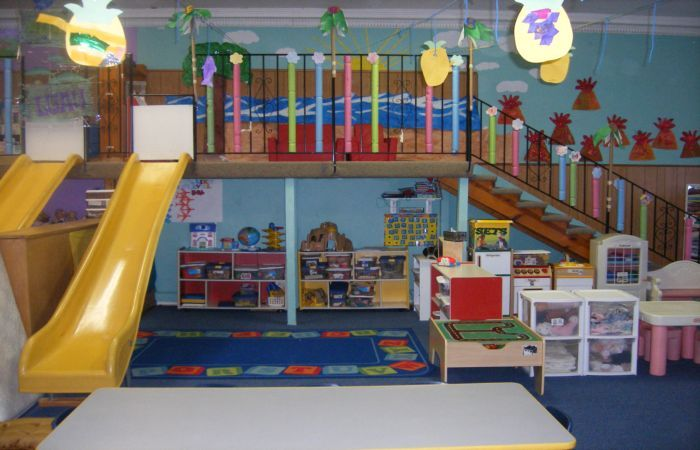Not Really Sure About The Color Scheme But The Loft And Slide Are Cool Indoor Preschool