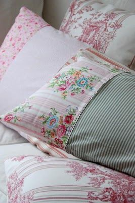 Very cute pillow covers - this looks like a good way to jazz up some plain pillow slips and maybe use up remnants of fabric.