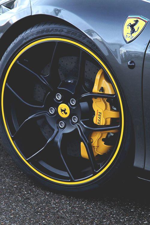 Ferrari.  I like the rims contrasted against the calipers
