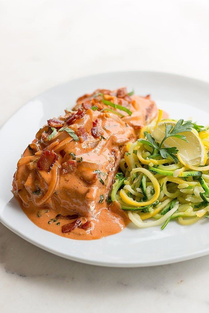 Salmon with Bacon Tomato Cream Sauce: A sexy dish with a luxurious tomato vodka cream sauce featuring bacon! Ready in 20 minutes.
