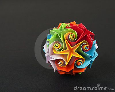 Origami sphere with stars made from colored paper isolated on black paper background.