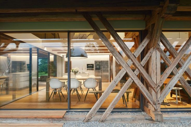 Slovenian firm, Styria Arhitektura have worked pure architectural magic by coverting a 15o-year-old hay barn into a gorgeous living space using as much materials they could salvage from the original structure.