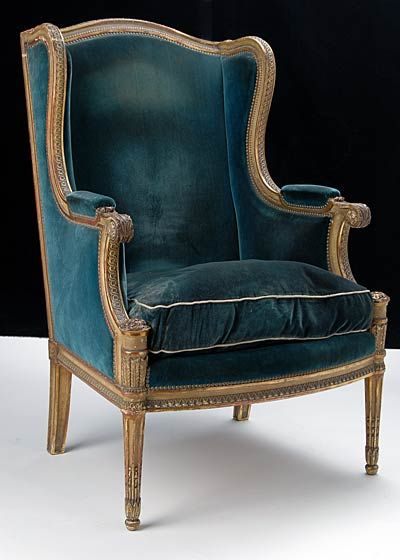 Winged bergere chair. Green velvet.