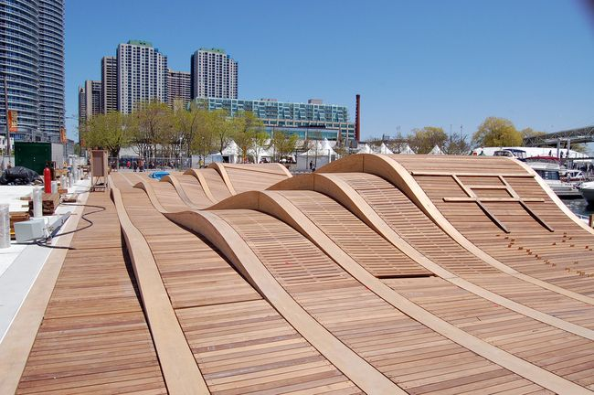"""Simcoe WaveDeck, Toronto, Canada THE SIMCOE WAVEDECK ON TORONTO'S HARBOURFRONT List under """"very cool installations."""" The best part about the wavedeck is that you can slide on it (because you know you want to!)."""