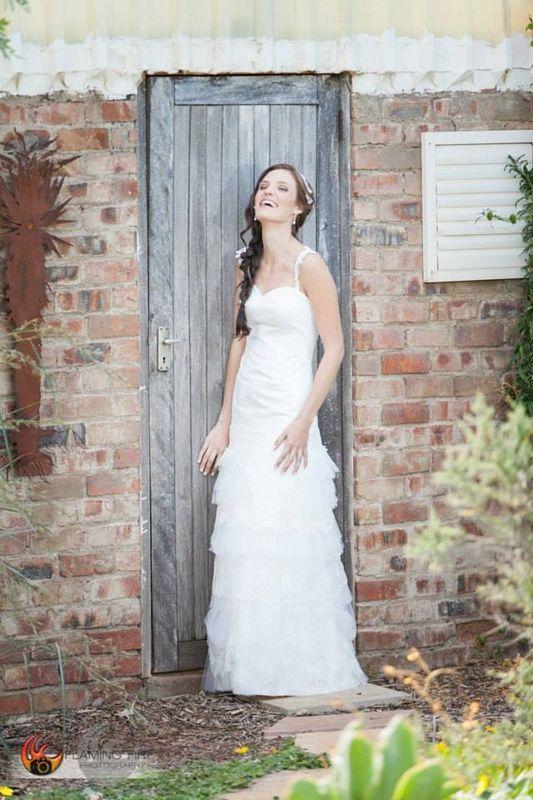 Classic custom wedding dress with tiered tulle & skirt + lace shoulder straps by Maryke www.maryke.co.za #WeddingDressesByMaryke Photo by www.flamingfireph...