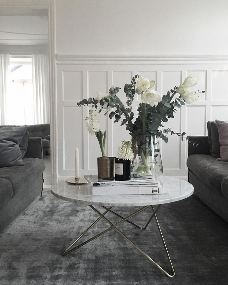 White and grey living room with velvet and marble accents. I love the way the coffee table was styled. #hairpinlegs #floralarrangement