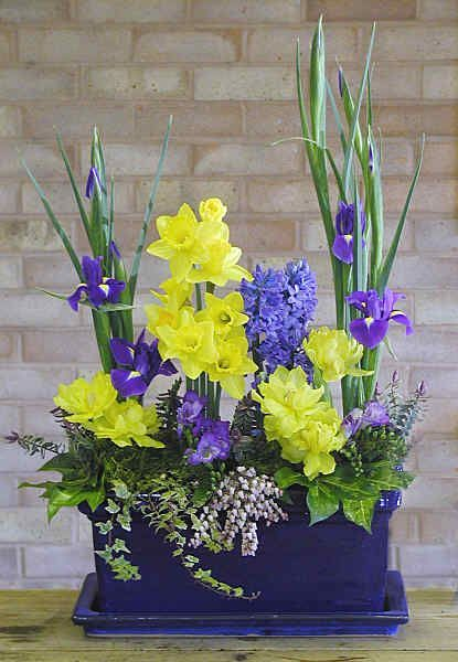 DESIGN 108 yellow daffodils are lovely against the blue purple iris, hyacinth and freesia