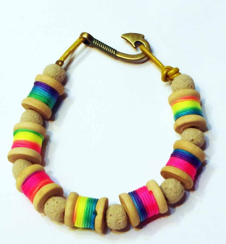 Authentic hand made bracelet with spools rainbow color thread and white lava anker clasp by SofiannasBracelets on Etsy