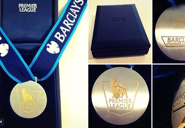 premier league medals - Google Search p Circular silver medal with a golden lion on it, inside a shield