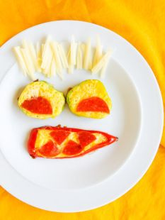 Happy Healthy Eggs | Courtesy of Lushious Eats | #Eggs #GetCracking Make breakfast time fun (while getting the kids to eat their veggies) by serving a healthy dish in a playful way. Use eggs, peppers, pepperoni, and cheese to make this happy face, which is bound to put a smile on the faces of your children.