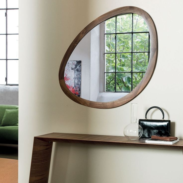 Named after the larger than life Surrealist painter, this unique mirror features an irregular formed frame made entirely from solid canaletta walnut. The original design and minimalistic nature provides a welcoming and sculptural feature for your  home.