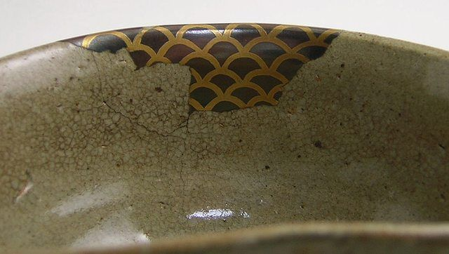 """The side of a """"makienaoshi"""" bowl - one which has had a large piece replaced, rather than just cracks repaired."""