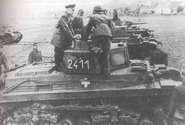 Army Group Commander Field Marshal Walter Model inspects Hungarian tanks.