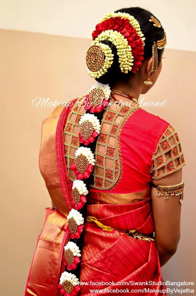 Traditional Southern Indian bride's bridal braid hair. Hairstyle by Swank Studio. Silk Saree. Sari Blouse Design. Hair Accessory. Temple jewelry. Jhumkis. Silk Kanjeevaram sari. Braid with fresh flowers. Tamil bride. Telugu bride. Kannada bride. Hindu bride. Malayalee bride. Find us at https://www.facebook.com/SwankStudioBangalore