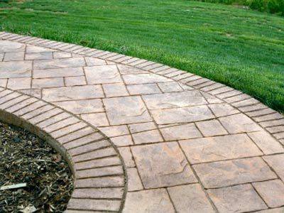 Love the brick border then maybe plain rough in middle - Stamped concrete walkway ideas ...