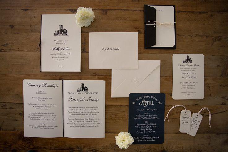 Elegant wedding suite on ivory cotton paper. Embossed detail. Black print. Place-card tags. Order of service. Hand-folded vintage v-shape envelopes with embossing detail. Chalkboard menu. Styling by Jani Venter. Photo by Rikki Hibbert.