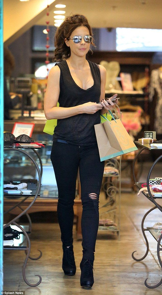 Looking good: Kate Beckinsale showed off her slender frame in a pair of skinny jeans and a plunging vest top as she enjoyed some retail therapy at Hearts Only boutique in Santa Monica, California on Monday