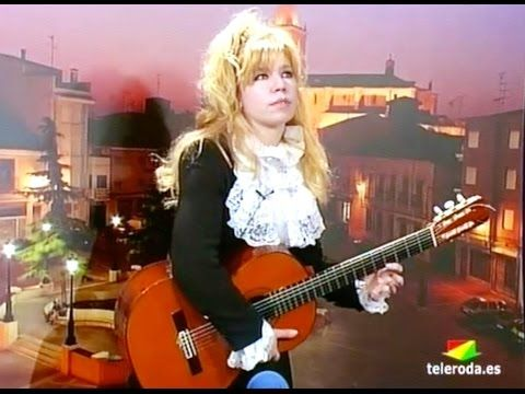 Galina Vale plays live - left hand Solo on Spanish Tv, exceptional  skills..