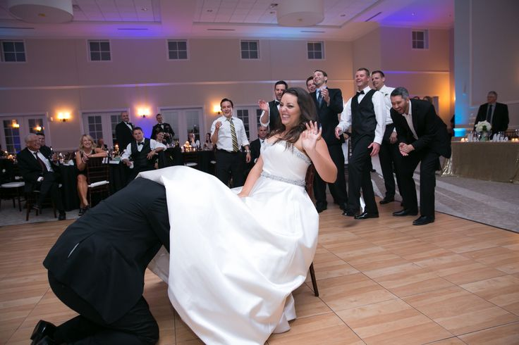 This is always a fun moment at weddings! #GarterRetrieval Photography: TRU Identity Photography & Designs