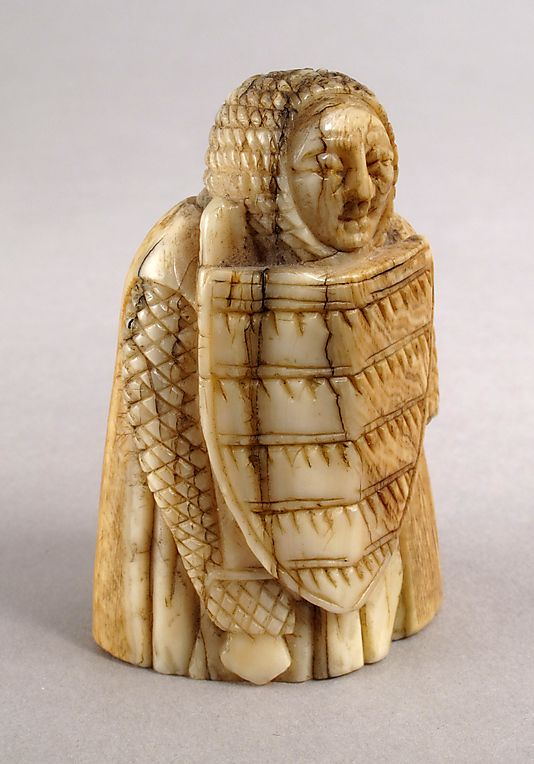 Whale Ivory Chess piece in the form of a Warder (Rook) or Pawn, 12th century Scandinavian.