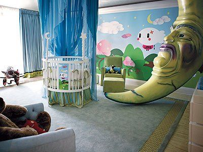 Christina Aguilera Nursery with an 11 foot moon. From qualitybath.com love the crib and curtain the moons face is creepy but love the idea