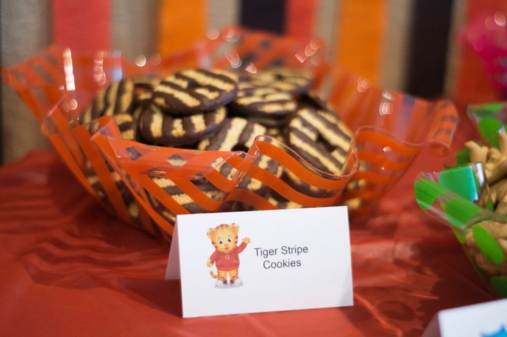Ideas for a cheap, Do-It-Yourself Daniel Tiger themed birthday party including decorations and food.