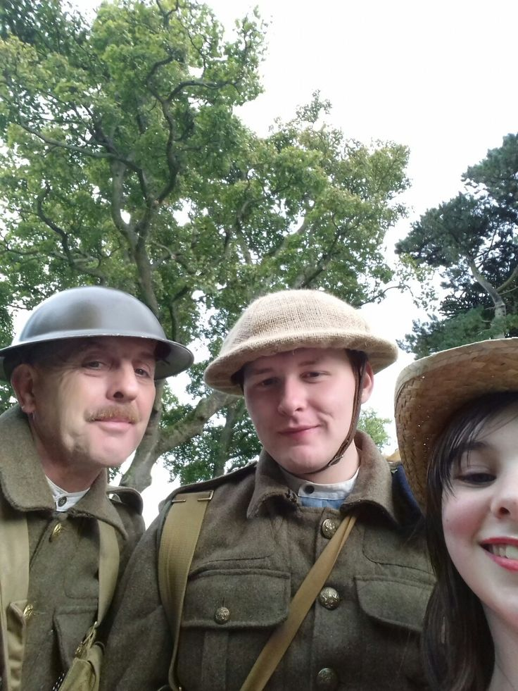 Selfie time I took a selfie with two men .they were acting out what the World War One would be like