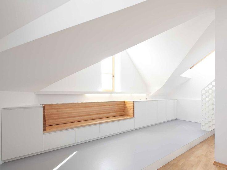 Beautiful wooden texture which gets accentuated through its abstract white surrounding. Darwingasse renovation by Schenker Salvi Weber Architekten..