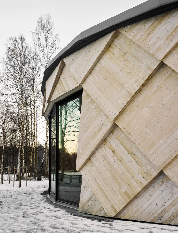 Pine cone-inspired trail centre in a Swedish nature reserve