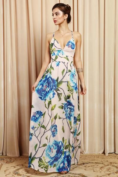 7b9863966689 Pretty bold flowers give this languid maxi romantic appeal that s ideal for garden  parties or weekend brunch.- criss cross back detail- spaghetti straps.