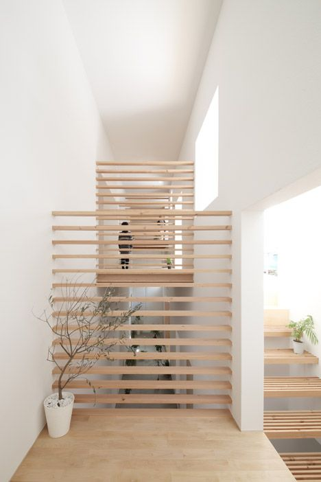 Katsutoshi Sasaki's House in Yamanote features sleeping platforms raised over an indoor terrace.