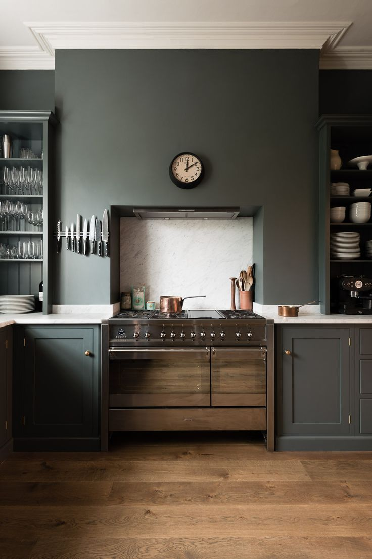 The cupboards, the colours, the honed Carrara marble worktop and the understated open cupboards either side of the cooker, perfection. deVOL Kitchens.