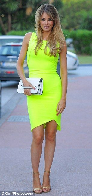 Looking good: TOWIE babe Chloe Sims sported a neon yellow dress for her evening out in the coastal Spanish city